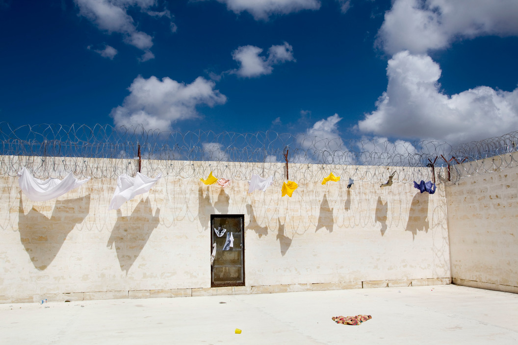 Malta. June 2009. Takandja Detention Center where the illegal immigrants will stay between six and eighteen months. They are 315 refugees including 48 women. Block A. Courtyards Rooms 1+ 2.