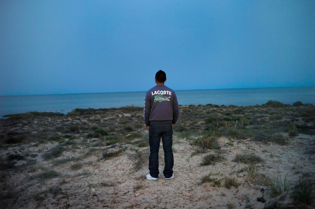 Zarzis, Tunisia, April 2011. Oussama,19, avril 2011., is a candidate for illegal immigration to France*, through Lampedusa in Sicilia. He is posing at the place where he will embarq very soon.